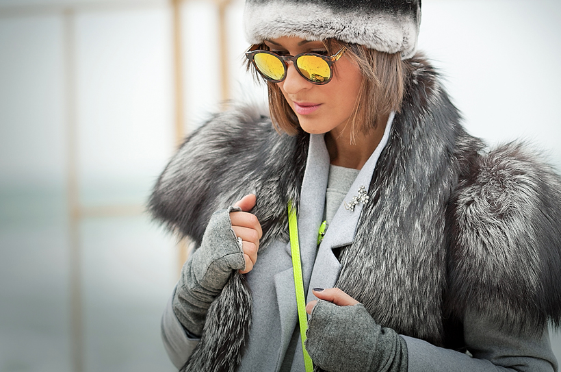 fur vest, orange mirror sunglasses, warm winter outfit,