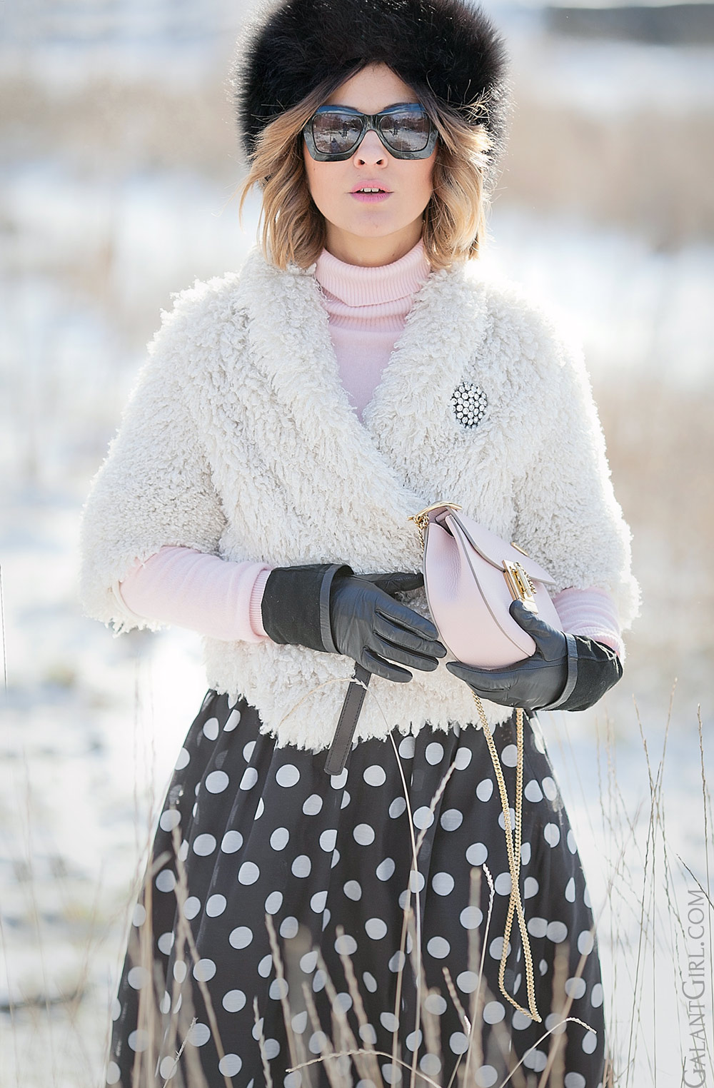 cold weather outfit for winter with faux fur coat and polka dot skirt