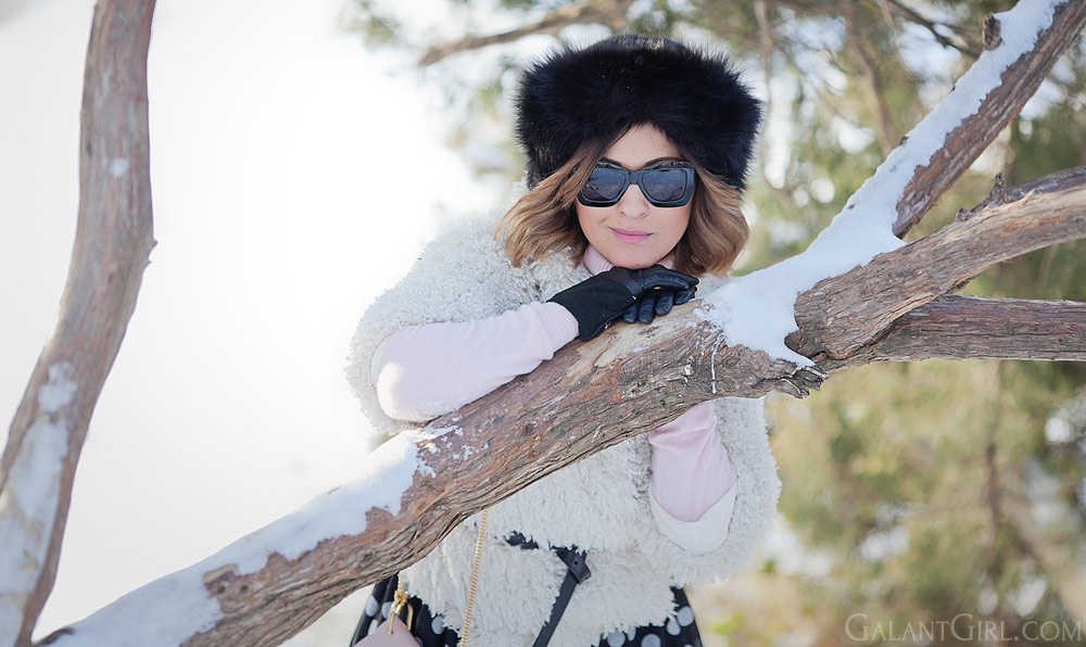 fur hat in russian style and faux fur coat for cold winter days