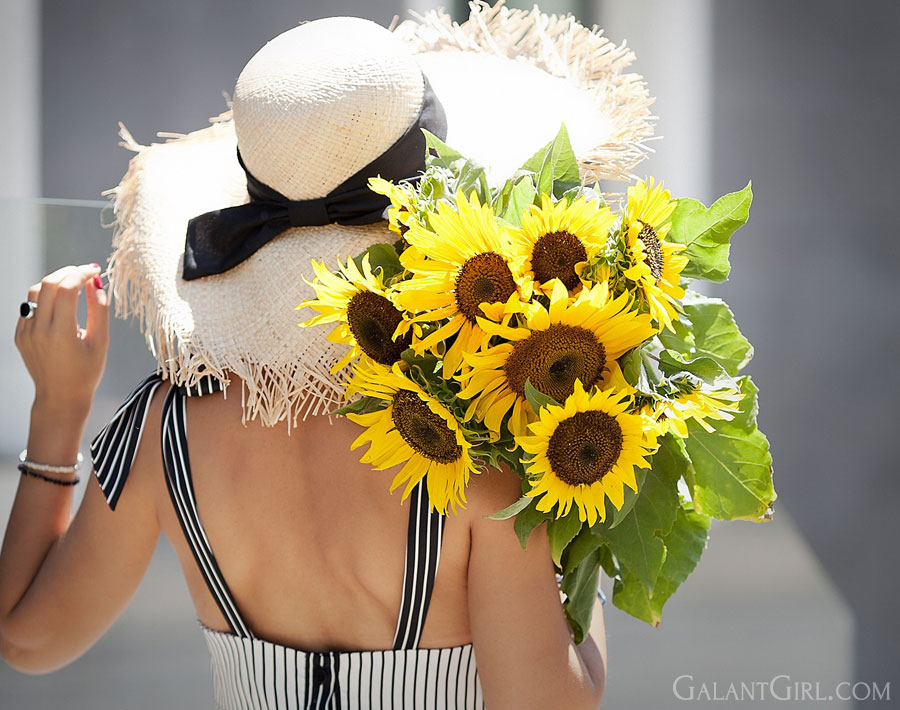 beautiful shot with sunflowers and straw hat