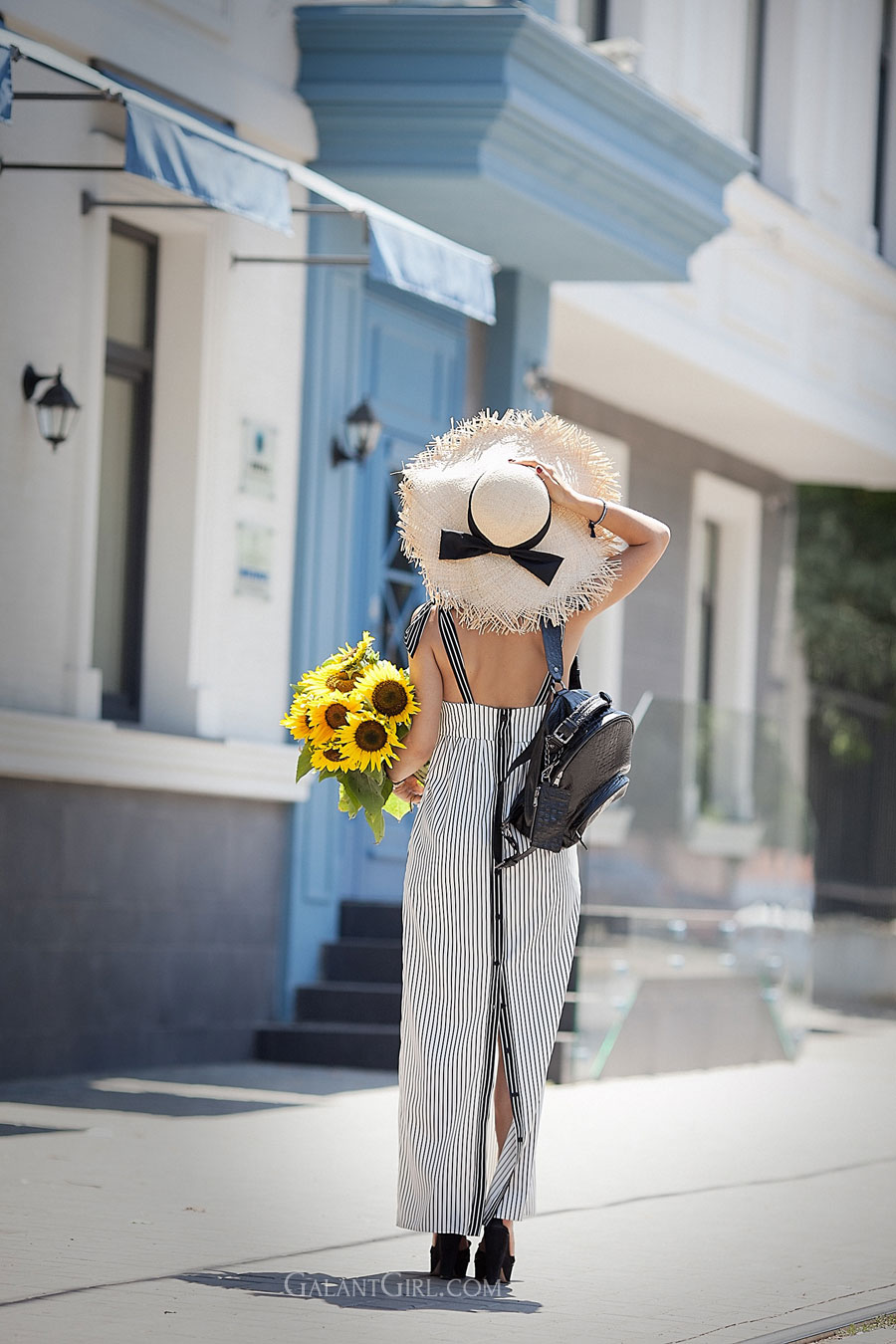 striped-dress_sunflowers_straw-hat_black-leather-backpack
