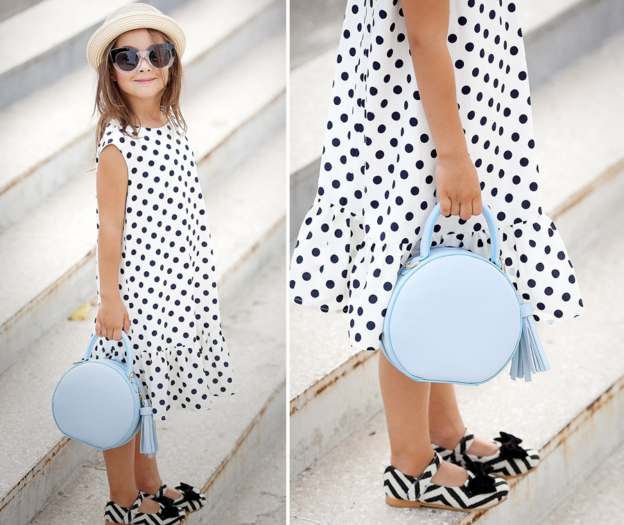 little girl with polka dot dress, leather hat bag,