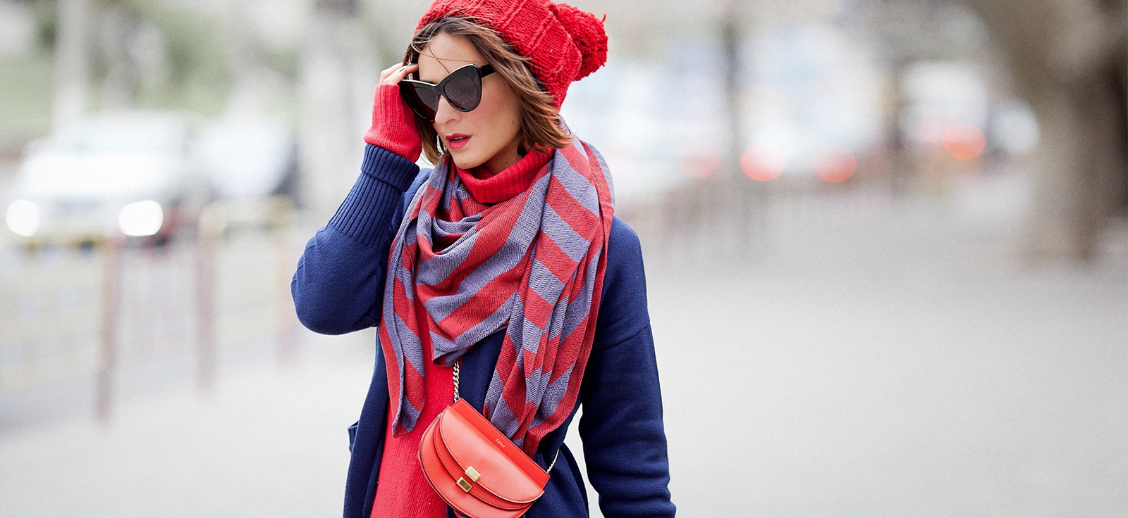 winter outfits with navy blue coat and red hat by Ellena Galant