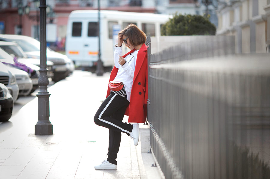 red coat outfit, red chloe bag, track pants outfit,